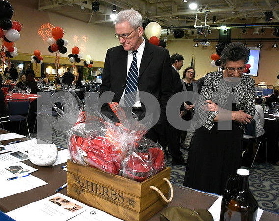 2/24/2018 Mike Orazzi | Staff Joe Janeczko and Angie Pirog look over silent auction items during the Women of Influence Gala held at CCSU Saturday evening in New Britain.