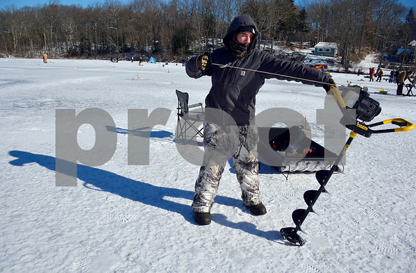 2/3/2018 MIke Orazzi | Staff John Bochicchio during the Terryville Fish & Game Club's annual ice fishing derby held on Middle Pond Saturday in Terryville.