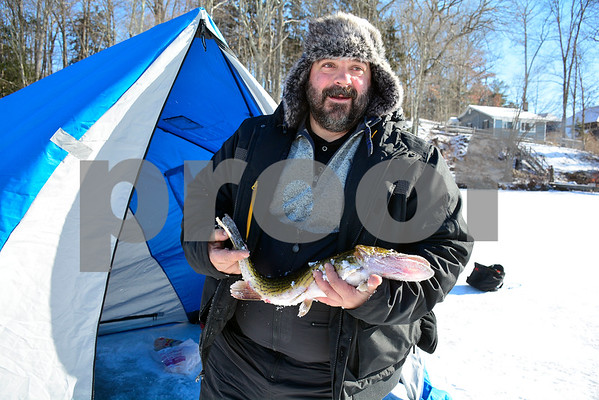 2/3/2018 MIke Orazzi | Staff Steve Manzone holds a 3lb 5 oz, 24 inch pickerel he caught during the Terryville Fish & Game Club's annual ice fishing derby held on Middle Pond Saturday in Terryville.
