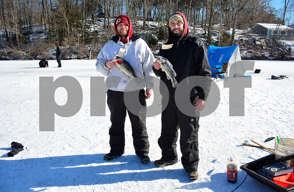 2/3/2018 MIke Orazzi   Staff Andrew Wright and James Borrelli hold a couple of large mouth bass they caught during the Terryville Fish & Game Club's annual ice fishing derby held on Middle Pond Saturday in Terryville.