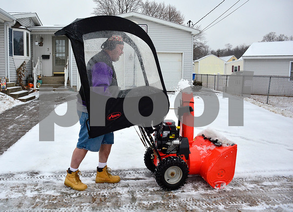 2/7/2018 Mike Orazzi | Staff Jerry (didn't want to give his last name) while clearing snow while dressed in shorts along West Gate Street in Bristol during Wednesday's storm.