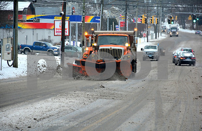 2/7/2018 Mike Orazzi | Staff A couple of state DOT plows on Route 6 during Wednesday's storm in Bristol near King Street.