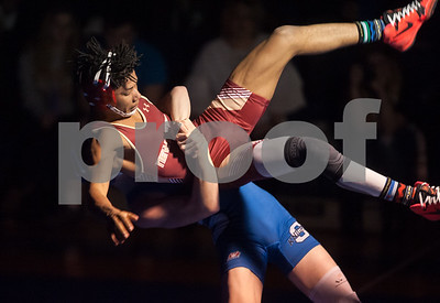 02/08/18  Wesley Bunnell | Staff  Southington's Dawson Welch vs New Britain's Elijah Wattson in the 132lb class contest at Southington High School on Thursday night.