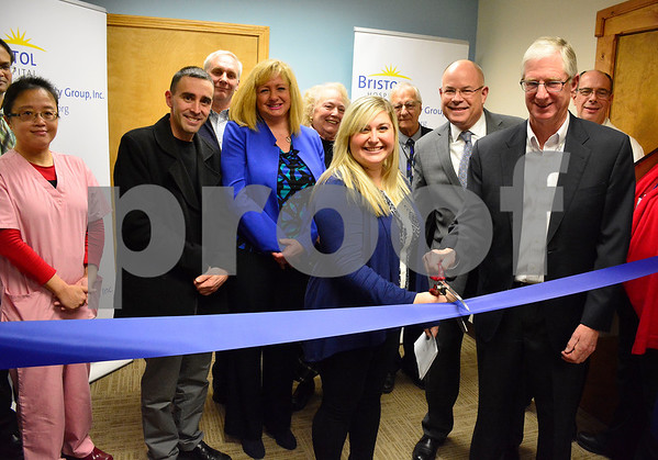 2/8/2018 Mike Orazzi | Staff The Greater Southington Chamber of Commerce Executive Director Taylor Crofton, Bristol Hospital President and CEO Kurt Barwis and Bristol Hospital Chairman of the Board Douglas Devnew cut a ribbon at the multi-specialty group's new Southington office at 98 Main Street Thursday evening.