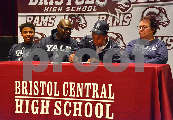 2/8/2018 Mike Orazzi | Staff Dathan Hickey signs to play football at Yale University as his brother Galen, father Rod and mother Pam look on during a ceremony at Bristol Central High School Thursday afternoon.