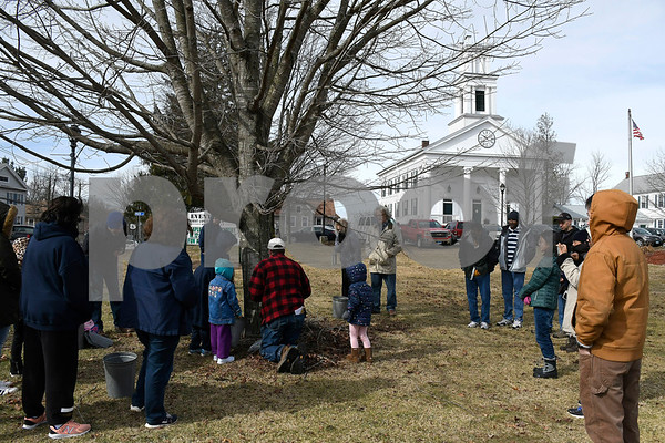 3/3/2018 Mike Orazzi | Staff Jerry Milne demonstrates how to tap Maple trees during the annual Maple Festival held on the Plymouth Green Saturday.