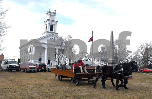 3/3/2018 Mike Orazzi | Staff Ken Wood drives Rex and Duke while giving horse drawn carriage rides during the annual Maple Festival held on the Plymouth Green Saturday.