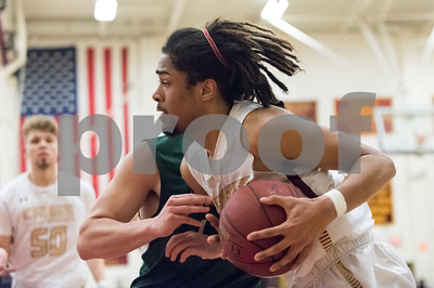 03/06/18  Wesley Bunnell | Staff  New Britain basketball defeated New Milford in the first round of the state tournament on Tuesday evening at New Britain High School. Jafari Newman (42).