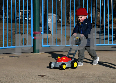 3/6/2018 Mike Orazzi | Staff Ethyn Oaks,2, operates a plastic lawn mower in Bristol's Rockwell Park Tuesday afternoon.