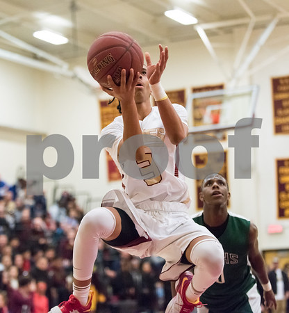 03/06/18 Wesley Bunnell | Staff New Britain basketball defeated New Milford in the first round of the state tournament on Tuesday evening at New Britain High School. Isaiah Jenkins (3).