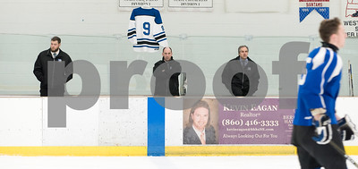 03/06/18  Wesley Bunnell | Staff  Hall-Southington hockey vs Conard in the first round of the state tournament at Veterans Ice Rink in West Hartford on Tuesday afternoon.  Head Coach Brian Cannon, middle, and assistant coaches look on as the team is introduced.  The jersey for injured captain Andrew Booth (9) hangs in the background.