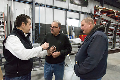 02/15/19  Wesley Bunnell | Staff  Sign Pro President Peter Rappoccio shows Craig Laviero and Bill Pietrowicz from Martin Laviero Construction a custom grommet designed and built by Sign Pro for the Beehive Bridge project. Mayor Erin Stewart along with other city employees visited Sign Pro in Southington on Friday morning for an update on Sign Pro's progress.