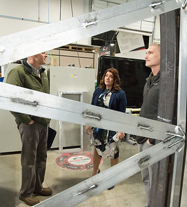 02/15/19  Wesley Bunnell | Staff  Mayor Erin Stewart is shown through a triangle cutout which will be fitted with a colored plexiglass trim piece for the upcoming Beehive Bridge project during a tour of Sign Pro in Southington on Friday afternoon as she stands with City Engineer Robert Trottier, L, and Director of Public Works Mark Moriarty.