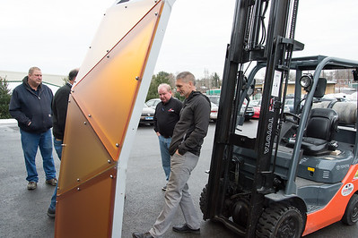 02/15/19  Wesley Bunnell | Staff  Director of Public Works Mark Moriarty examines a colored plexiglass trim piece which is to be installed on the Beehive Bridge project as Sign Pro Senior Project Manager Ray Carroll looks on. Mayor Erin Stewart visited the manufacturer, Sign Pro, along with other city employees on Friday for a project update.