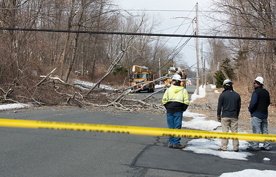 02/25/19  Wesley Bunnell | Staff  High winds caused a large tree to fall near the intersection of Farmstead Rd and Hightower Rd in Southington pulling down electrical wires and snapping an electrical pole at the base.  Crews look down Farmstead Rd towards the tree lying across the rd.