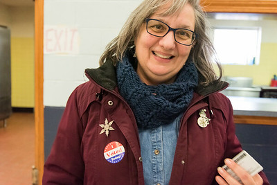 02/26/19  Wesley Bunnell | Staff  Approximately 120 voters as of 2:00pm at the VFW Post 511 Memorial Hall voting location for the 6th state Senate District seat. Cathy Teti smiles after placing her I Voted sticker on her jacket.