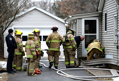 2/27/2019 Mike Orazzi | Staff Plainville Firefighters while extinguishing a reported small electrical fire on Bartlett Street in town Wednesday afternoon. No one was injured and no more information was available.