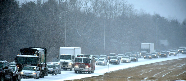 2/12/2019 Mike Orazzi | Staff Backed up traffic on Route 72 in Plainville after an MVA during Tuesday's storm.