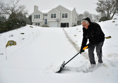 2/12/2019 Mike Orazzi | Staff Michael Lodovico while clearing snow from his driveway on Oehler Drive in Bristol during Tuesday's storm.