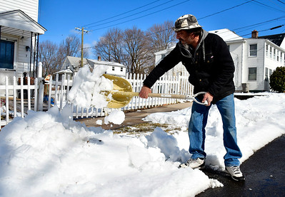 2/13/2019 Mike Orazzi | Staff Dan Caron while clearing snow along North Pond Street in Bristol Wednesday.