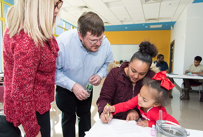 02/13/19  Wesley Bunnell | Staff  The New Britain Housing Authority launched a new program on Thursday to help residents with education, financial, mental health and job opportunities. Client Francesca Ayala holds her 3 year old daughter Skylar Reyes as she completes paperwork while Education Advocate Linda Langan and Ken House from the housing authority look on.