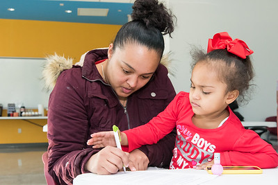 02/13/19  Wesley Bunnell | Staff  The New Britain Housing Authority launched a new program on Thursday to help residents with education, financial, mental health and job opportunities. Client Francesca Ayala holds her 3 year old daughter Skylar Reyes as she completes paperwork.