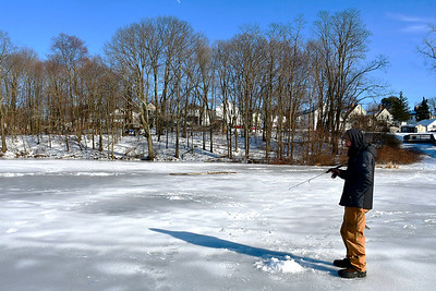 2/14/2019 Mike Orazzi | Staff Osvaldo Rivera while ice fishing on Birge Pond in Bristol Thursday afternoon.