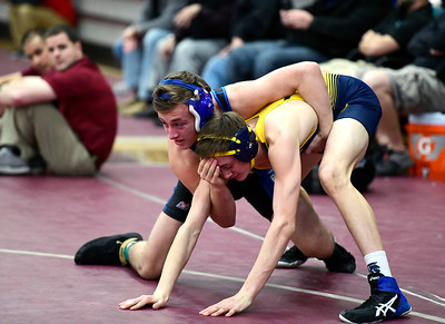2/16/2019 Mike Orazzi | Staff Bristol Eastern's Alexander Marshall and Simsbury's Aiden Brown during the CIAC state open wrestling tournament at Bristol Central High School in Bristol Saturday.