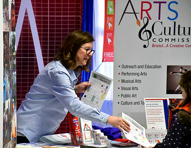 2/16/2019 Mike Orazzi | Staff Bristol Development Authority's Dawn Nielsen passes out information during the 34th annual Bristol Home & Business Show at Bristol Eastern High School on Saturday.