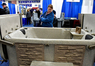 2/16/2019 Mike Orazzi | Staff Brigitte Ayotte looks over a spa on display during the 34th annual Bristol Home & Business Show at Bristol Eastern High School Saturday.
