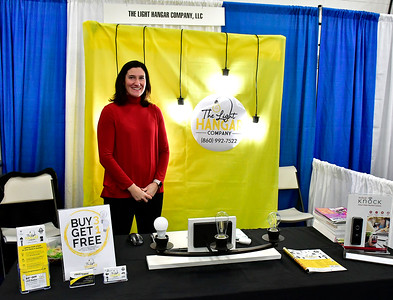 2/16/2019 Mike Orazzi | Staff The Light Hangar Company's Laura Davis during the 34th annual Bristol Home & Business Show at Bristol Eastern High School Saturday.