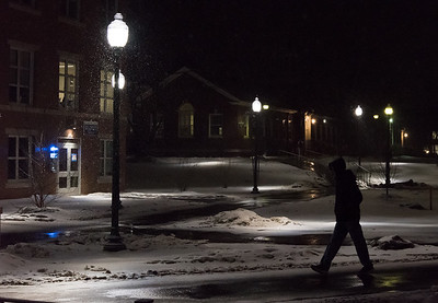 02/20/19  Wesley Bunnell | Staff  Snow falls around the CCSU campus on Wednesday night as a student makes his way to the newly renovated Williard-DiLoreto Halls.