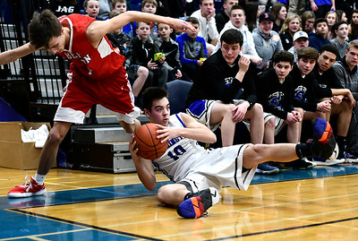 2/21/2019 Mike Orazzi | Staff Berlin High School's Holden Murphy (15) and Southington's Jared Kelly (10) during the CCC Boys Basketball Tournament in Southington Thursday night.