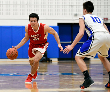 2/21/2019 Mike Orazzi | Staff Berlin High School's Alexander Halkias (24) and Southington's Jared Kelly (10) during the CCC Boys Basketball Tournament in Southington Thursday night.