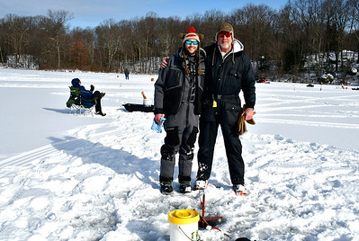 2/2/2019 Mike Orazzi | Staff Tim Fagan and his father Gary Fagan while fishing on Middle Pond for the Terryville Fish & Game Club's annual Ice Fishing Derby Saturday in Plymouth.