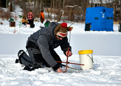 2/2/2019 Mike Orazzi | Staff Tim Fagan while fishing on Middle Pond for the Terryville Fish & Game Club's annual Ice Fishing Derby Saturday in Plymouth.