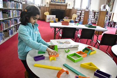 2/2/2019 Mike Orazzi | Staff Roniya Malik,6, works on crafts while at the New Britain Public Library on Saturday.