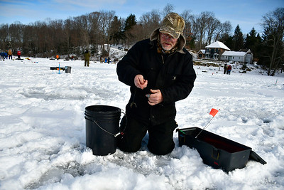2/2/2019 Mike Orazzi | Staff Joe O'Neil while fishing on Middle Pond for the Terryville Fish & Game Club's annual Ice Fishing Derby Saturday in Plymouth.