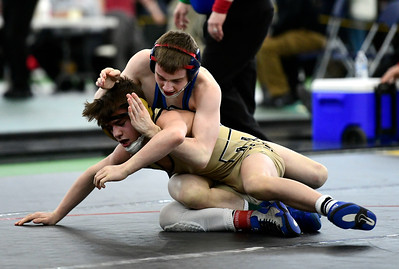 2/22/2019 Mike Orazzi | Staff Bristol Eastern's Trent Thompson and Trumbull's Michael Longo and in a 106 pound match during the CIAC State Open Wrestling Tournament at the Floyd Little Athletic Center in New Haven Saturday.