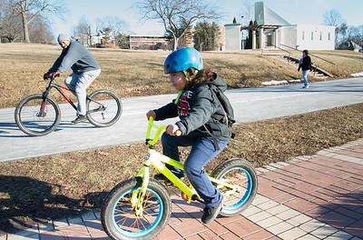 02/05/19  Wesley Bunnell | Staff  Hanley Marine, age 6, rides his bike with his father Miguel Marine through Walnut Hill Park on a pleasant Tuesday afternoon.
