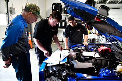 2/5/2019 Mike Orazzi | Staff Crowley Ford Service Technician Tom Mangum works with Norwich Technical High School students Austin Smith and Mark Wheeler during part of the 2019 CARA Challenge Tuesday morning in Plainville.