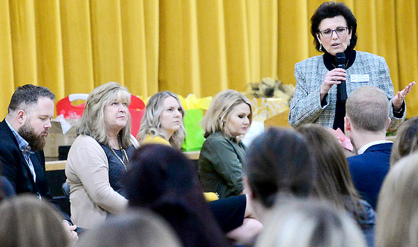 KEVIN HARVISON | Staff photo Standing far right, Donna Gradel, 2018 Oklahoma Teacher of the Year speaks to those attending the McAlester Public Schools Teacher of the Year ceremony. Seated from left are the MPS Teacher of the year candidates, Mark Price, Robin Steidley, Taylor Smith and Jennifer Lewis.