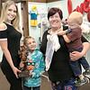 KEVIN HARVISON | Staff photo<br /> Executive Director McAlester Main Street Alyssa Latty, left, presents Beene Srouts Boutique with the McAlester Main Street Chocolate Tour Award. Pictured from left, Alyssa Latty, Hunter Beene, Courtney Beene, owner and Colton Beene. Courtney Beene said, I have tow boys Hunter, 7 and Colton, 1. The idea of Beene Sprouts began out of frustration over the lack of local options for cute boys clothing so I decided to do something about it. We opened up at the end of November. We hve boys clothing from four lines, Beene Sprouts is the perfect place to find an outfit for school, church, holidays or family pictures sizes newborn to 8. When I was pregnant I had to purchase all my maternity clothes either out of town or online so we have maternity clothes with more coming next month. We also have a promothing going on, if you spend $50 before taxes you get a $5 coupon to the Companss.