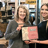 KEVIN HARVISON | Staff photo<br /> Common Roots was the winner of the Top Sales Award for most tickts sold to the Chocolate Tour. Pictured from left, Kristen Lloyd, owner Common Roots, and Alyssa Latty, executive director, McAlester Main Street.