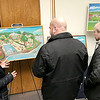 KEVIN HARVISON | Staff photo<br /> A group of people have a discussion while looking over some Oklahoma Folk Art at the Pittsburg County Library Tuesday evening.