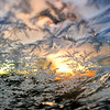 KEVIN HARVISON | Staff photo<br /> A windshield of a vehicle was the perfect canvas for ice crystals and the sun rise to create a temparary piece of morning art.