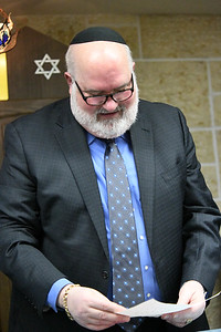 Rabbi Lipper looks at a handmade card from one of the young members of Temple Kol Tikvah.