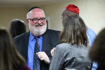 Rabbi David Lipper speaks with Davidson College President Carol Quillen in advance of his installation service.