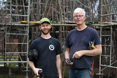 Artist Patrick Dougherty (right) and his son Sam at the end of day two on the site at Davidson College.