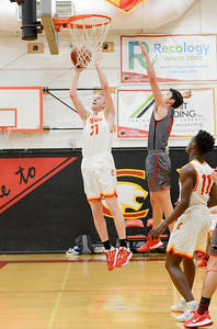 Chico's Jasten Del Carlo (left) drives by Foothill's Bekdoo Lewis (right) for a layup Tuesday at The Pit. (Matt Bates -- Enterprise-Record)